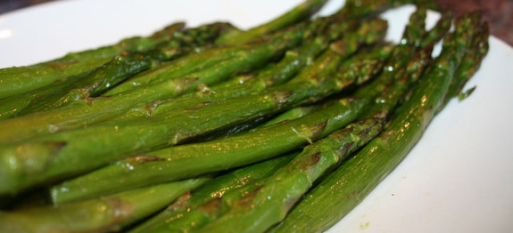Lightly coat asparagus in olive oil, spread onto baking sheet with space between, roast 375F until brown and goey.